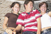 Portrait of teenagers laying on hammock together — Stock Photo