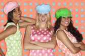 Teenage girls posing with hats and polka dots — Stock Photo