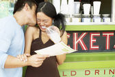 Couple kissing in front of coffee bar — Stock Photo