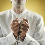 Young man praying — Stock Photo #23232726