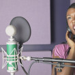 AfricAmericwomsinging in recording studio — Stockfoto #23231364
