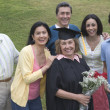 Older graduate posing with family - Foto Stock