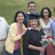 Stock Photo: Older graduate posing with family