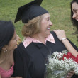 Stock Photo: Older graduate receiving praise from family