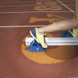 Stock Photo: Athletes feet in starting blocks