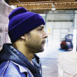 Profile of man in warehouse - Stock Photo