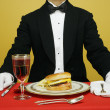 Waiter with hamburger — Stock Photo
