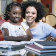 Stock Photo: Girl with pencil and woman