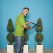 Royalty-Free Stock Photo: Portrait of man trimming trees