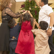 Stock Photo: Hispanic family decorating Christmas tree