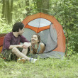 Young couple at their campsite - Foto Stock