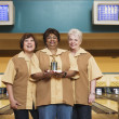 Women with trophy at bowling alley — Stock Photo