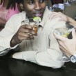 Young man having a drink — Stock Photo