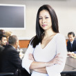 Businesswoman standing in front of group — Stock Photo