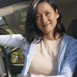 Woman posing in driver seat of SUV — Stock Photo