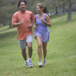 Couple running in the park — Stock Photo