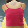 Young woman with tattoo on back - Foto Stock