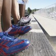 Close up of track athletes legs and shoes - Stock Photo