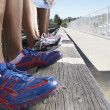 Stock Photo: Close up of track athletes legs and shoes