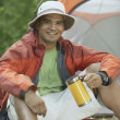 Young man at his campsite — Stock Photo
