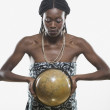 Young woman in traditional African dress holding globe — Stock Photo