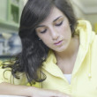 Teenage girl studying in a laboratory — Stock Photo