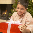 Hispanic boy with Christmas gift — Foto Stock