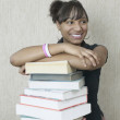 Teenage girl with stack of books — Stock Photo