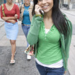 Girlfriends hanging out with mobile phone — Stock Photo #23232512
