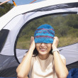 Woman pulling knit hat over her eyes — Stock Photo