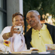 Senior couple taking picture of themselves — Stock Photo #23232584