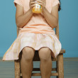 Young girl drinking juice — Stock Photo