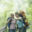 Young women hiking together in a forest — Stock Photo