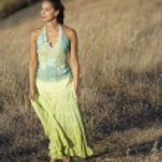 Woman walking among wild grasses — Stock Photo