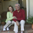 Stock Photo: Senior Hispanic couple sitting on steps