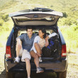 Stock Photo: Couple posing inside SUV hatch