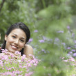 Portrait of a young woman lying in a garden — Stock Photo