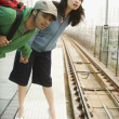 Young couple at train station — Stock Photo