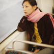 Asian woman on train — Stock Photo
