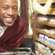 African American couple shopping for vitamins — Stock Photo