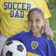 Stock Photo: Soccer girl posing with her father