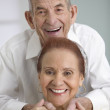 Portrait of elderly couple smiling — Stock Photo #23233292
