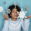 Young woman with snowflake mobile - Stock Photo