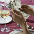 Stock Photo: Counting money in restaurant
