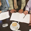Stok fotoğraf: Business professionals reviewing paperwork