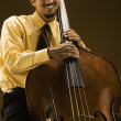 Man with double bass instrument - Stock Photo
