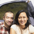 Couple posing outside their tent — Stock Photo