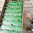 Two boys playing foosball - Stock Photo