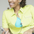 Woman wearing headset holding mobile phone - Stock Photo