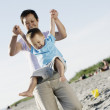 Mother playing with son at beach — Stock Photo